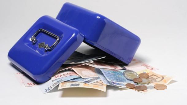 Geldkassette - Fotoillustration zum Thema Kassensturz
