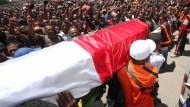 Wut und Trauer: Beerdigung in Madagaskar