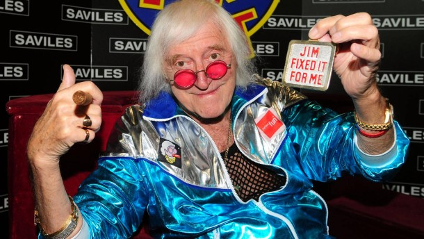 Savile reunited with Jim'll Fix It chair