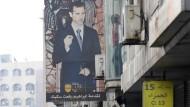 Der syrische Präsident als Plakat in den Straßen von Damaskus am Dienstag
