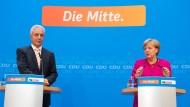 Absage an die AfD: Ministerpräsident Stanislaw Tillich und die CDU-Bundesvorsitzende Angela Merkel bewerten in Berlin die Wahl in Sachsen.