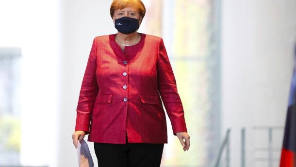 Merkel kündigt zusätzliche Beschränkungen für Corona-Hotspots an