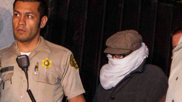File photo of Nakoula Basseley Nakoula escorted out of his home by Los Angeles County Sheriff's officers in Cerritos, California