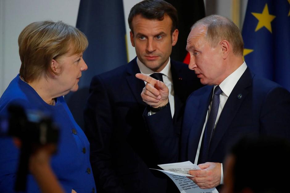 Wer gibt die Richtung vor? Merkel, Macron und Putin im Elysée-Palast