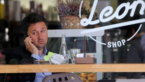 A guest uses his mobile phone in coffee bar in downtown Maribor