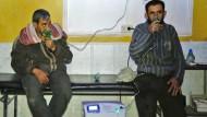 Syrer nach einer mutmaßlichen Giftgasattacke in Douma