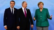 Wollen zu Syrien-Gesprächen nach Istanbul kommen: Macron, Putin und Merke, hier beim G-20-Gipfel in Hamburg