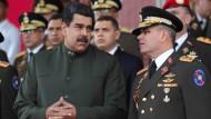 Traute Zweisamkeit? Zwischen Präsident Nicolás Maduro (l.) und Generalstabschef Vladimir Pardino (r.) könnte ein Machtkampf entbrennen.