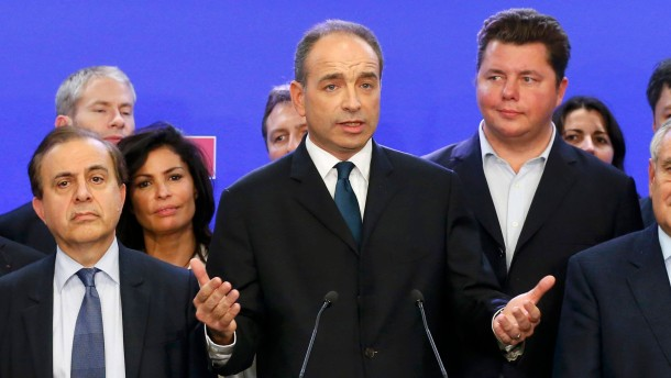 French politician Cope claims victory in a close election vote to head the UMP political party during a news conference at their headquarters in Paris