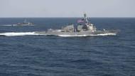Amerika lassen im Insel-Streit mit China Muskeln spielen