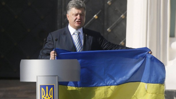 Ukraine's President Petro Poroshenko attends a ceremony marking the Day of the State Flag in Kiev