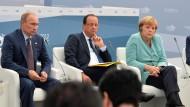 Wladimir Putin, François Hollande und Angela Merkel beim G-20-Gipfel im Jahr 2013 in St. Petersburg.