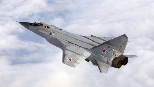 Handout photo of a Mikoyan MiG-31aircraft over an unknown location during a military exercise