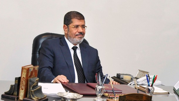 Egypt's President Mohamed Mursi meets one of his presidential advisors and assistant Ayman Aly at the presidential palace in Cairo