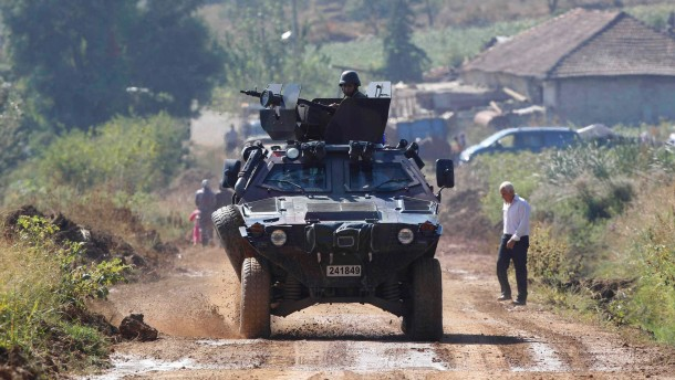 Turkish soldiers in a military vehicle patrol on the Turkish-Syrian border near the village of Hacipasa