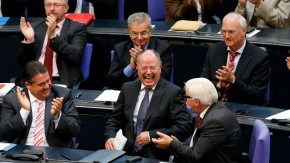 Steinbrueck, top candidate for chancellor of the Social Democratic Party (SPD) in the upcoming German general elections laughs after his speech during a debate of the lower house of parliament Bundestag in Berlin