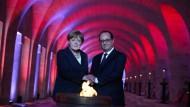 Angela Merkel und François Hollande gedenken im Beinhaus von Douaumont den Gefallenen der beiden Nationen.