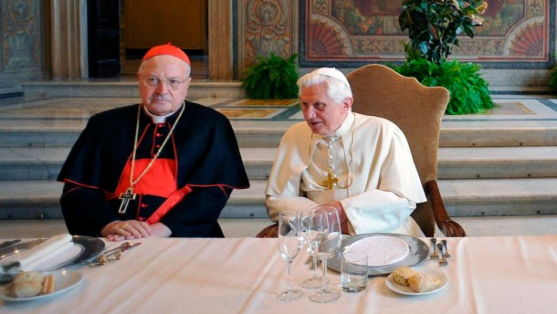 Pope Benedict XVI sits with Italian cardinals during a lunch offered to the cardinals to mark his fifth anniversary of pontificate at the Vatican