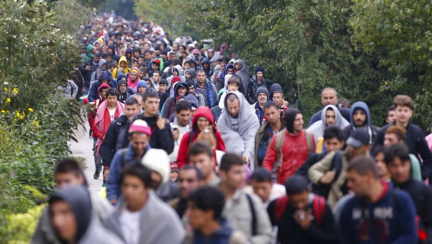File photo of migrants walking to the Austrian border in Nickelsdorf from Hegyeshalom