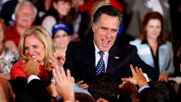 Mitt Romney and his wife Ann greet supporters at his Florida primary night rally in Tampa