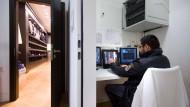 Durchblick: Ein Detektiv der Sicherheitsfirma VSD überwacht ein Herrenmodegeschäft in Frankfurt.