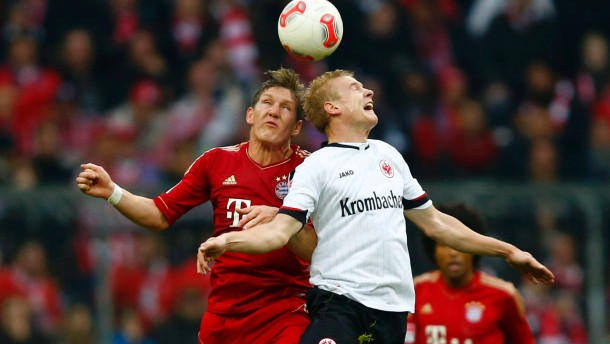 Sebastian Rode of Eintracht Frankfurt challenges Bastian Schweinsteiger of Bayern Munich during their German first division Bundesliga soccer match in Munich
