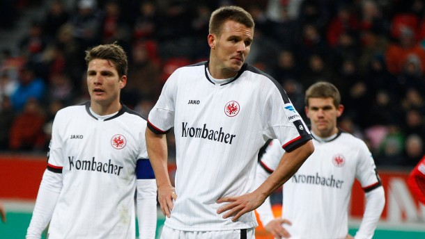 Eintracht Frankfurt's Schwegler, Meier and Jung react during the German first division Bundesliga soccer match against  Bayer Leverkusen in Leverkusen