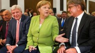 Lang scho nimmer g´sehn: Ministerpräsident Bouffier, Kanzlerin Merkel und Börsen-Chef Weimer (rechts)