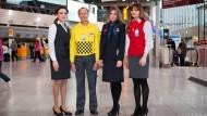 Grundfarbe Grau: Gayane Balasanyan, Maurice Tirant, Tatjana Schütz und Elzana Kapidizic von Fraport (von links)