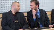 Widerspruch: Der wegen Mordes an einem Polizisten verurteilte Mann und sein Verteidiger wollen das Urteil nicht hinnehmen