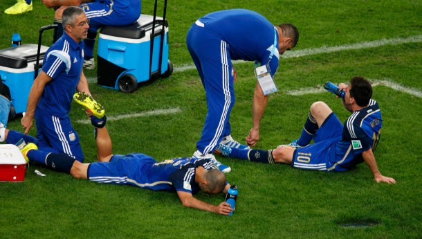 Argentina's players rest before extra time in their 2014 World Cup final against Germany at the Maracana stadium in Rio de Janeiro