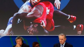 President of the International Olympic Committee (IOC) Jacques Rogge (bottom C) listens to the presentation of wrestling to be included as an Olympic sport in Buenos Aires