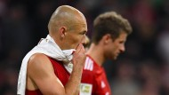Unerwartet düstere Mienen nach Spielschluss: Die Bayern Robben und Müller hatten nicht mit einem remis gerechnet