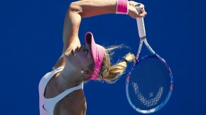 Witthoeft of Germany serves to McHale of the U.S. during their women's singles match at the Australian Open 2015 tennis tournament in Melbourne