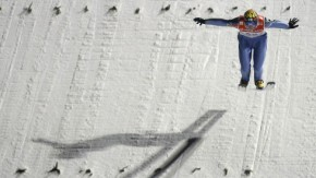 Finland''s ski jumper Ahonen lands the decisive jump to win the for the third event of the Four Hills ski jumping tournament in Bischofshofen