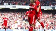 Selbst beim Jubeln noch einsam: Kuyt und Torres (r.) feiern ihr Tor - von Sunderlands Spielern ist nichts zu sehen