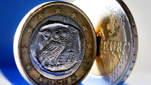 Auf welche Seite fällt die Münze? Griechenland kämpft gegen die Schulden