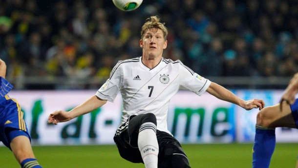 Germany's Bastian Schweinsteiger controls the ball during their 2014 World Cup qualifying soccer match against Kazakhstan at Astana Arena in Astana
