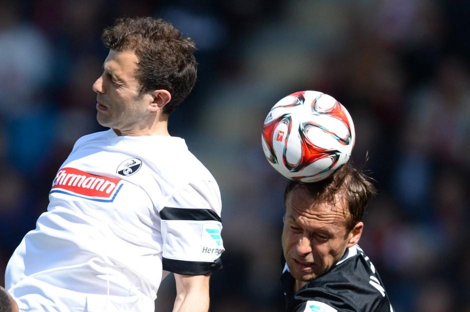 Noveski challenges Freiburg's Admir Mehmedi