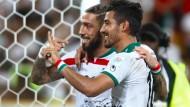 Gucci war's: Der in Berlin geborene Ashkan Dejagah (l.) zeigt, wer in der Nachspielzeit das erste Unentschieden des Asien-Cups verhindert hat