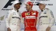 Hamilton und Vettel (v.l.n.r.) stehen im Mittelpunkt –  doch auch Valtteri Bottas hofft auf seinen großen Moment.