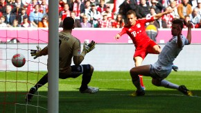 Bayern Munich's Rafinha scores a goal against Nuremberg's goalkeeper Raphael Schaefer during their German first division Bundesliga soccer match in Munich