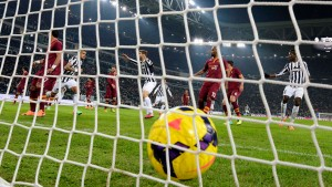 Juventus' Vidal celebrates after scoring against AS Roma during their Italian Serie A soccer match at the Juventus stadium in Turin