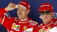 """Das hat großen Spaß gemacht"": Sebastian Vettel (links) startet am Sonntag vor Ferrari-Kollege Kimi Räikkönen."