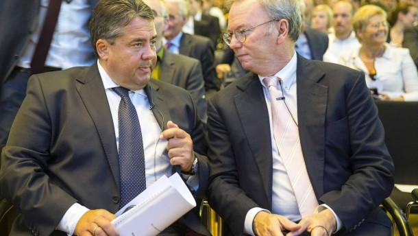Google Executive Chairman Schmidt and German Economy Minister Gabriel speak falling on a panel  discussion in Berlin