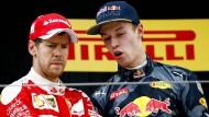 Zwei, die sich einiges zu sagen haben. Sebastian Vettel (links) und Daniil Kwjat.