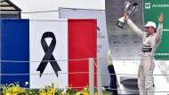 Gebremster Jubel: Auch Nico Rosberg stand unter dem Eindruck der Ereignisse von Paris.