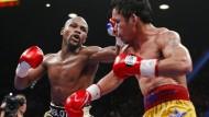 "Floyd Mayweather (links) keilt gegen Manny Pacquiao: ""Schlechter Verlierer"" und ""Feigling"""