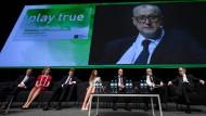 Der Direktor der Rusada (Hintergrund), Juri Ganus, auf der großen Videoleinwand beim Anti-Doping-Symposium der Wada.