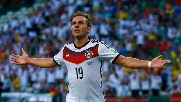 Germany's Goetze celebrates after scoring against Ghana during their 2014 World Cup Group G soccer match at the Castelao arena in Fortaleza